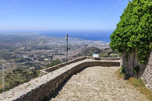 Fotografie, Obraz  Erice in Sicily, view from road around Castello di Venere towards sea and city of Trapani
