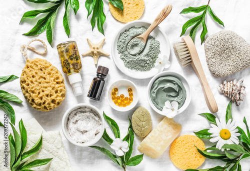 Flat lay beauty skin care ingredients, accessories. Natural beauty products on a light background, top view