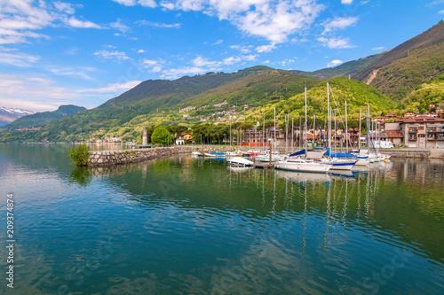 Fotobehang Groen blauw Port of Gera Lario with moored boats in sunny summer day. Lombardia, Italy