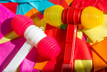 Bright Colorful Plastic Toy Hammers And Bunting For Celebrating The Feast Of St. John The Baptist In Porto, Portugal