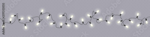Fotografia  Christmas and New Year garlands with glowing light bulbs