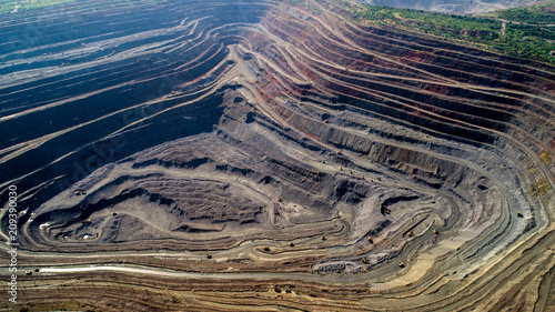 Photo sur Aluminium Taupe Aerial view of opencast mining quarry with lots of machinery at work.