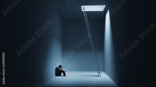 A man is sitting depressively in a room with a ladder