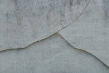 Gray Texture Of A Concrete Wall With A Crack