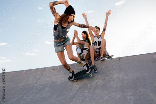 Fotografie, Obraz  Skater girl rides on skateboard at skate park