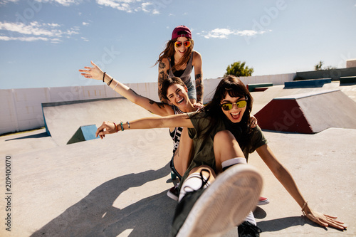 Friends playing with skateboard at the skate park