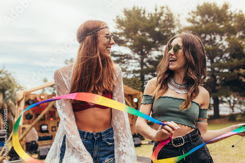 Young women enjoying at music festival.