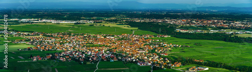 Keuken foto achterwand Groene Wide aerial high resolution panoramic view of sunset over the green valley of vineyards, Alsace