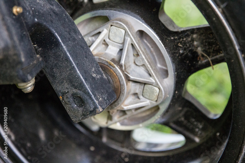 Fotografie, Obraz  Back side of golf cart wheel