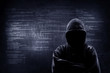 canvas print picture - Internet crime concept. Hacker working on a code on dark digital background with digital interface around.