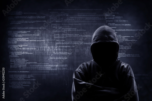 Fototapeta Internet crime concept. Hacker working on a code on dark digital background with digital interface around. obraz