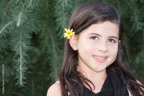 Pretty young girl with flower in her hair II