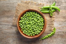 Flat Lay Composition With Green Peas On Wooden Background