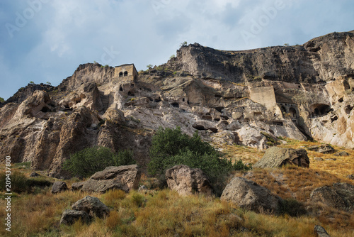 Monastery of Vardzia. Stones in the background of the cave city. Landscape. Journey to Georgia. #209437800