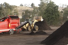 Large Industrial Machinery Being Used At A Garbage Dump Mixing And Excavating Green Waste Mulching It Into Compost In Rural New South Wales, Australia