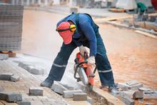 Construction Worker Cuts Walkw...