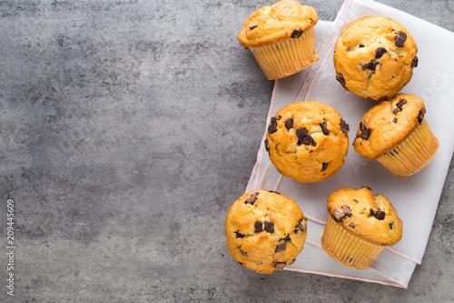 Fototapeta  Homemade chocolate muffins on the vintage background.