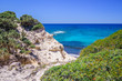 Beach, Greece - Kos Island, Kefalos: Picturesque deep blue Caribbean Bay with wild sea of Greek Agais and steep sandstone cliffs, perfect for wind surfers with heavy waves