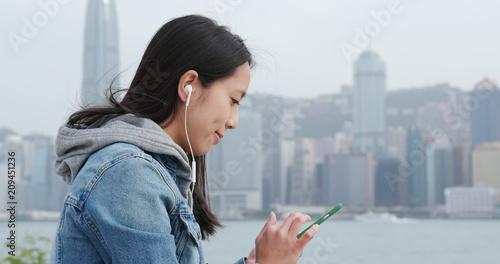 Woman enjoy music at outdoor - 209451236