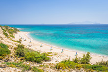 Beaches, Greece, Kos Island, Cap Helona: Beautiful Holiday Setting On A Secluded Beach With Umbrellas On The Greek Aegean Sea With Turquoise Waters And A Picturesque Bay And Islands In The Background