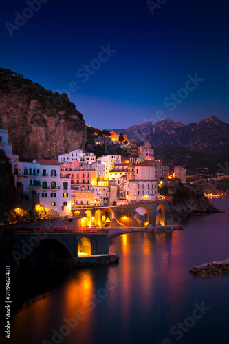Spoed Fotobehang Milan Night view of Amalfi cityscape on coast line of mediterranean sea, Italy