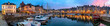 canvas print picture - Panoramic view at dusk of the beautiful Honfleur harbour, which offers many fine restaurants overlooking the water