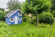 Cozy Little Blue Playhouse In A Green Garden