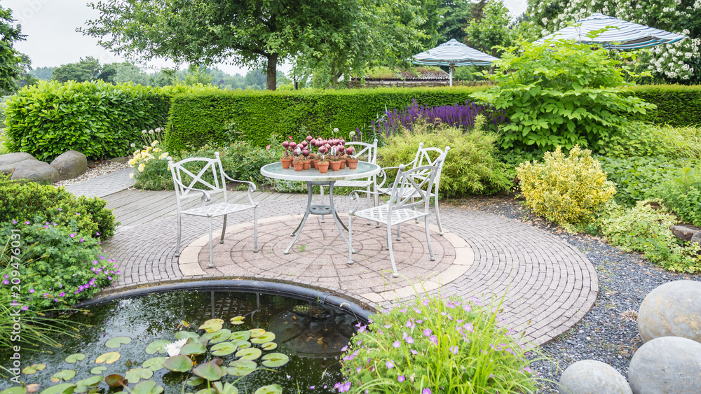 Fototapety, obrazy: Garden with pond and classic white chairs and table on a patio