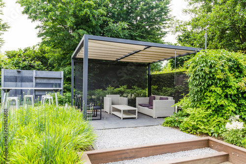 Poster Garden Garden design with grey metal rooftop and patio