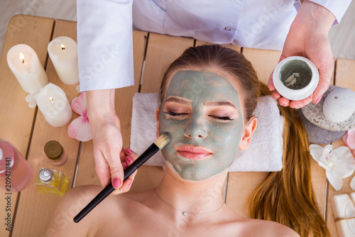 Fototapety, obrazy: Young woman in spa health concept with face mask