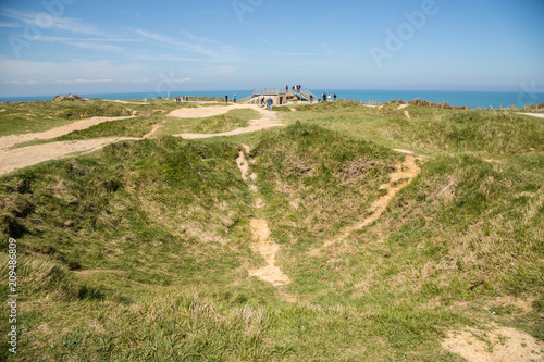 Poster  Tourists at the German bunkers at Pointe Du Hoc, Normandy, which were captured b
