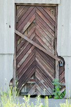 Old Wooden Door.Background And Texture Of Old Boards.