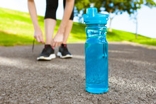 Drinking Water And Fitness Concept. Bottle Of Water Next To Runner.