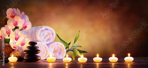 fototapeta na ścianę Spa Concept - Massage Stones With Towels And Candles In Natural Background