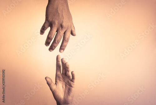 Hand helping hand. People helping each other concept. Wallpaper Mural