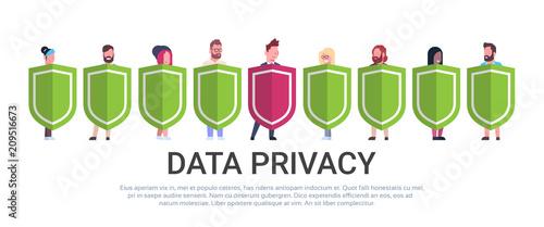 Fotografía  business man hold shield mix race team GDPR data privacy on white background net