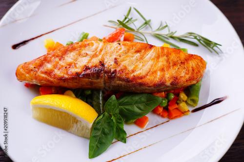 Delicious Grilled Salmon Steak With Vegetable Garnishing Restaurant