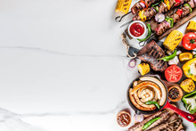 Assortment Various Barbecue Food Grill Meat, Bbq Party Fest - Shish Kebab, Sausages, Grilled Meat Fillet, Fresh Vegetables, Sauces, Spices, White Marble Background, Above Copy Space