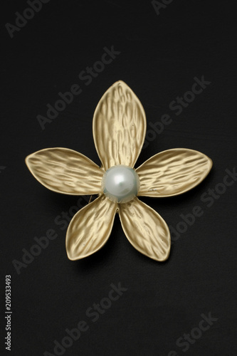 8bc9be5d22952 golden brooch flower with pearl isolated on black - Buy this stock ...