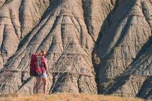 Girl Hiker Against Badland
