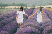Two Women Walking Together At ...
