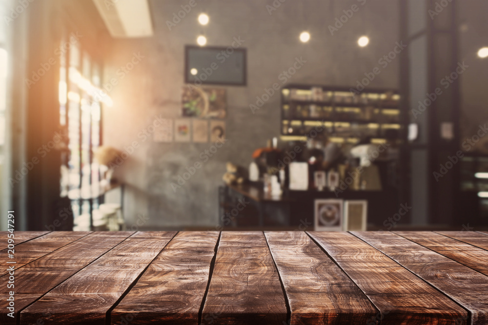 Fototapety, obrazy: Empty old wood table top and blurred bokeh cafe and coffee shop interior background with vintage filter - can used for display or montage your products.