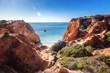 Red rocks and blue sea on the Atlantic coast in Portugal, Algarve region, beautiful stunning bright landscape