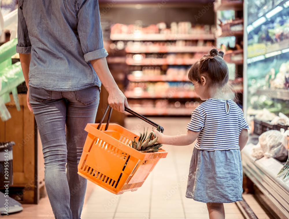 Fototapety, obrazy: Mom and daughter are shopping at the supermarket