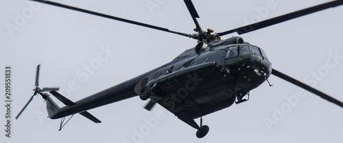Tuinposter Helicopter HELICOPTER - Military transport machine in the air