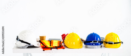Safety helmet and equipment work of the engineers, construction on the white table Wallpaper Mural