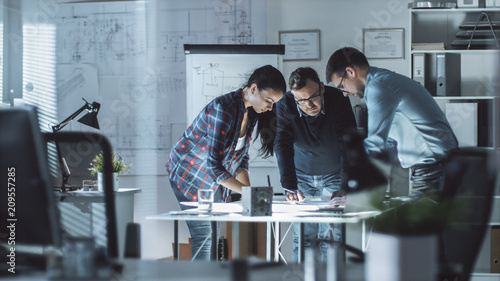 Three Design Engineers Have a Working Meeting about Project Wallpaper Mural