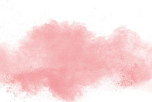 Abstract Pink Powder Explosion On White Background. Freeze Motion Of Pink Dust Splattered.