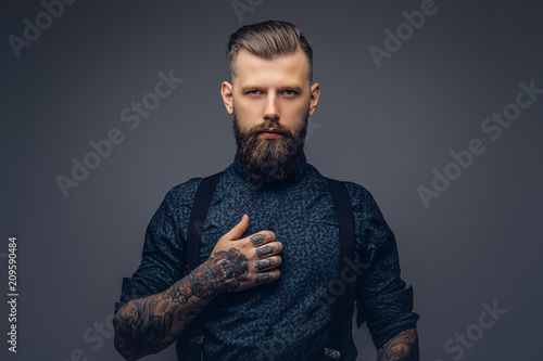 Portrait of a serious handsome old-fashioned hipster in shirt and suspenders Canvas Print