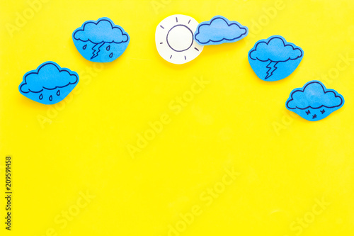 Obraz Modern weather icons set on yellow background top view copy space - fototapety do salonu